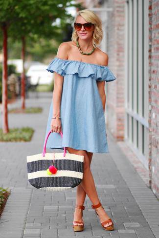 How to Wear a Green Necklace: Super stylish, this combo of a light blue swing dress and a green necklace provides with wonderful styling opportunities. A pair of brown leather heeled sandals instantly kicks up the oomph factor of any look.