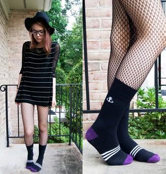 How to wear: black and white horizontal striped swing dress, black mesh long sleeve t-shirt, black wool hat, black socks