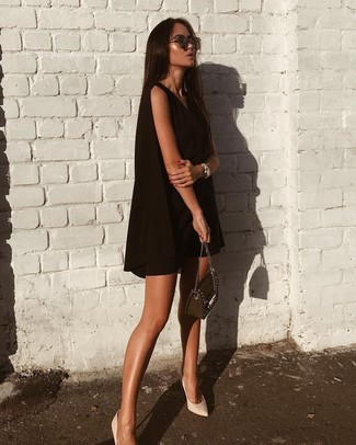 How to wear: black swing dress, white leather pumps, black embellished leather crossbody bag, dark brown sunglasses
