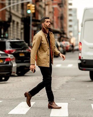 How to wear: tan barn jacket, black crew-neck t-shirt, black jeans, brown leather cowboy boots