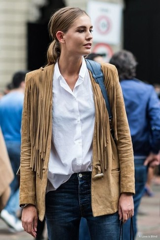 How to wear: tan fringe suede biker jacket, white dress shirt, navy skinny jeans, blue leather tote bag