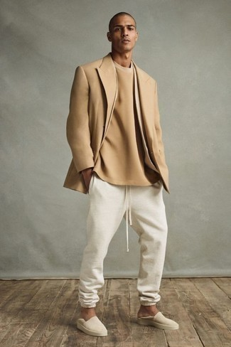 Beige Suede Loafers Outfits For Men: If you're hunting for an off-duty yet seriously stylish outfit, consider wearing a tan blazer and white sweatpants. Introduce a pair of beige suede loafers to this getup for a touch of polish.