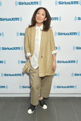 How to wear: tan blazer, white silk dress shirt, tan wide leg pants, black and white leather low top sneakers