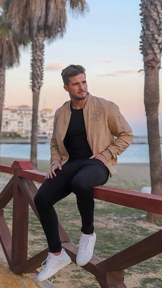 Black Jeans Spring Outfits For Men: This relaxed casual combination of a tan bomber jacket and black jeans is extremely easy to pull together in next to no time, helping you look on-trend and prepared for anything without spending a ton of time combing through your wardrobe. For something more on the daring side to round off your look, introduce white athletic shoes to the equation. This is a winning option for a cool ensemble that transitions easily into spring.