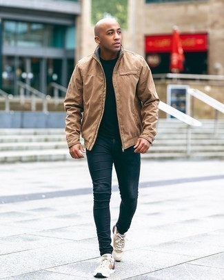 Men's Outfits 2020: This casual combination of a tan bomber jacket and navy skinny jeans will draw attention for all the right reasons. If you need to instantly dial down your ensemble with shoes, complete your outfit with beige athletic shoes.