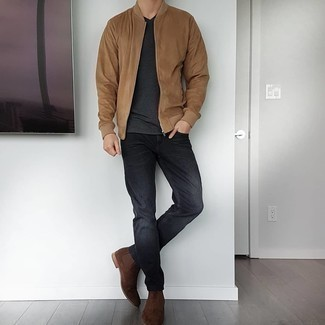 Charcoal Jeans Fall Outfits For Men: Wear a tan bomber jacket with charcoal jeans to assemble a casual and cool outfit. Bring a more elegant twist to this getup by rounding off with a pair of dark brown suede chelsea boots. This outfit is a viable option if you're putting together a standout ensemble for transeasonal weather.