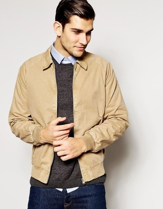 Reach for a tan bomber jacket and deep blue jeans for an easy to wear,