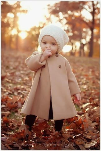How to wear: tan coat, white beanie, black tights