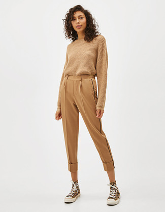 How to wear: tan crew-neck sweater, tan tapered pants, yellow canvas high top sneakers