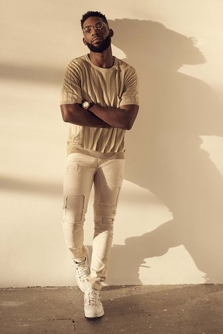 How to wear: tan crew-neck t-shirt, beige ripped skinny jeans, white low top sneakers, brown watch