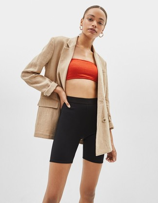 How to wear: tan double breasted blazer, red cropped top, black bike shorts, gold earrings