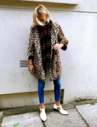 How to wear: tan leopard fur coat, blue skinny jeans, white cutout leather ankle boots, red plaid scarf