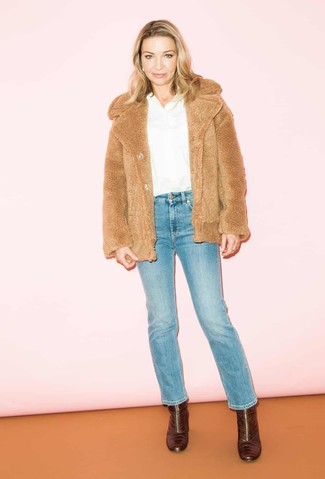 How to wear: tan fur jacket, white long sleeve blouse, blue jeans, burgundy leather ankle boots