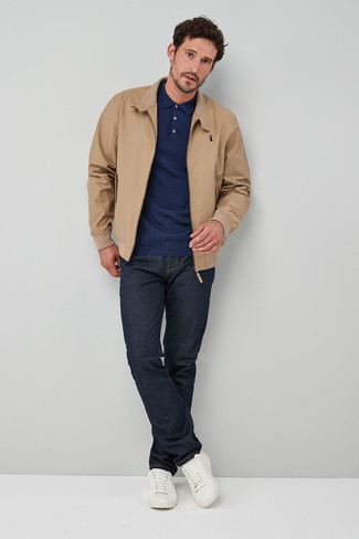 How to wear: tan harrington jacket, navy polo neck sweater, navy jeans, white leather low top sneakers