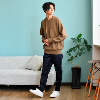 Men's Outfits 2021: A brown knit hoodie and navy chinos paired together are the perfect look for guys who love laid-back outfits.