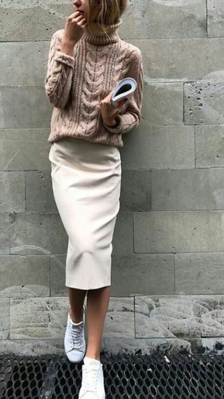 How to Wear a White Pencil Skirt: This combination of a tan knit turtleneck and a white pencil skirt is a fail-safe option when you need to look phenomenal but have no time to dress up. For something more on the relaxed side to round off this ensemble, add white leather low top sneakers to the mix.