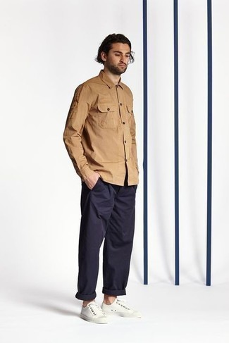 Tan Long Sleeve Shirt Outfits For Men: For a look that's very easy but can be modified in a great deal of different ways, consider teaming a tan long sleeve shirt with navy chinos. On the shoe front, go for something on the casual end of the spectrum and complete your ensemble with white canvas low top sneakers.