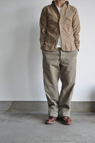 Brown Leather Casual Boots Outfits For Men: This casual combination of a tan long sleeve shirt and khaki chinos comes in handy when you need to look stylish but have no extra time to craft a look. For something more on the dressier side to finish off your getup, complement this ensemble with a pair of brown leather casual boots.