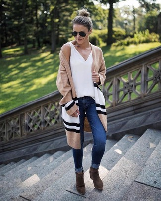 Effortlessly blurring the line between chic and casual, this combination of a tan horizontal striped open cardigan and navy skinny jeans is likely to become one of your favorites. A good pair of olive boots are sure to leave the kind of impression you want to give. A look like this is ideal for in-between weather.