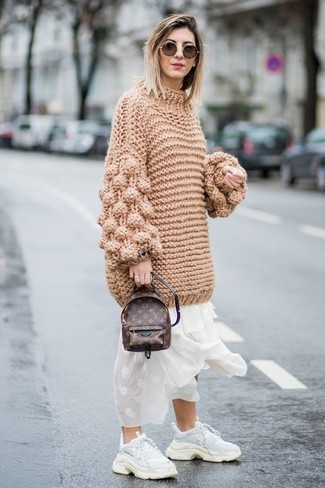 How to wear: tan knit oversized sweater, white chiffon maxi dress, white athletic shoes, dark brown leather backpack