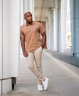 Men's Outfits 2020: This casual combo of a tan polo and beige chinos is very easy to put together without a second thought, helping you look sharp and ready for anything without spending a ton of time going through your wardrobe. White canvas low top sneakers pull the outfit together.