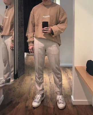 Beige Chinos Outfits: Opt for a tan print long sleeve t-shirt and beige chinos to create a casually cool look. Feeling inventive today? Spice up your getup by slipping into grey print canvas high top sneakers.