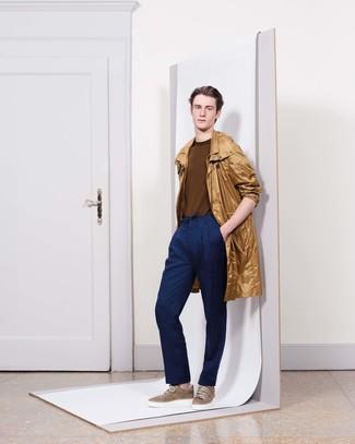 How to wear: tan raincoat, brown crew-neck sweater, navy dress pants, brown low top sneakers