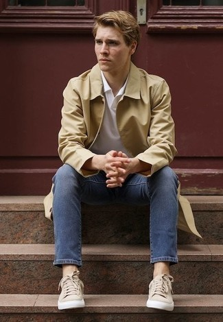 How to Wear a Coat For Men: On days when comfort is critical, go for a coat and blue jeans. Beige canvas low top sneakers are guaranteed to give an extra touch of refinement to this look.