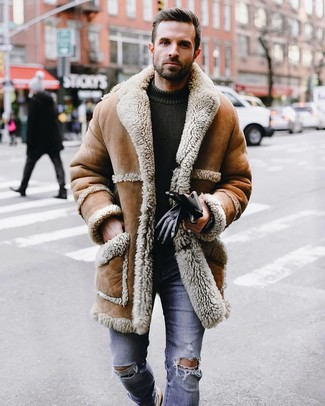 How to wear: tan shearling coat, olive knit crew-neck sweater, blue ripped skinny jeans, black leather gloves