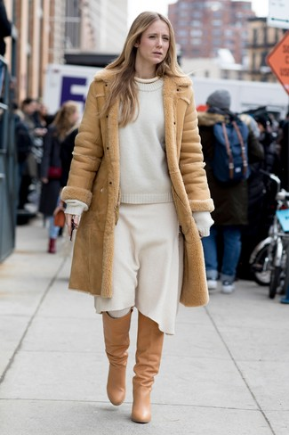 How to wear: tan shearling coat, white crew-neck sweater, white wool midi skirt, tan leather knee high boots