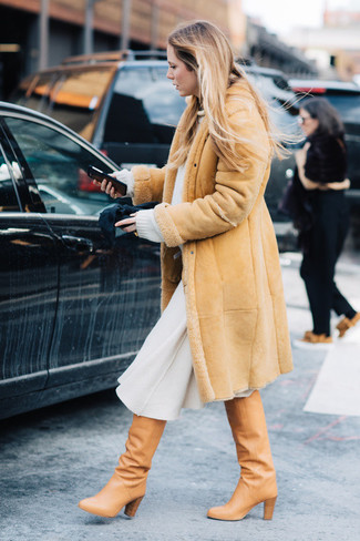 How to wear: tan shearling coat, white oversized sweater, white wool midi skirt, tan leather knee high boots