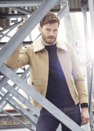 Jamie Dornan wearing Tan Shearling Jacket, Black Crew-neck Sweater, White Vertical Striped Long Sleeve Shirt, Navy Jeans