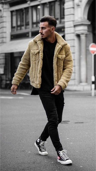 How to wear: tan shearling jacket, black crew-neck t-shirt, black skinny jeans, black and white canvas high top sneakers