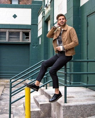 How to wear: tan suede shirt jacket, beige horizontal striped crew-neck sweater, black chinos, black leather derby shoes
