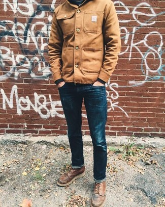 How to wear: tan shirt jacket, black sweatshirt, navy skinny jeans, brown leather casual boots
