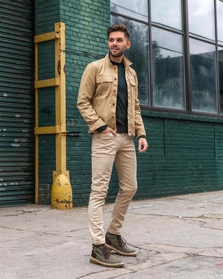 How to wear: tan shirt jacket, dark green crew-neck sweater, beige jeans, dark green canvas casual boots