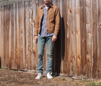 Blue Ripped Jeans Outfits For Men: For an off-duty look, dress in a tan shirt jacket and blue ripped jeans — these pieces fit perfectly well together. A pair of white canvas low top sneakers integrates nicely within a myriad of combos.
