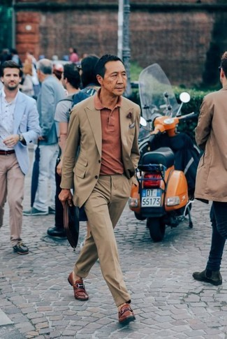 Consider wearing a tan suit and an orange polo to ooze class and sophistication. Take your look into a sportier direction with Alden Leather Penny Loafers. Totally summer-friendly, you can rock a version of this ensemble all summer long.