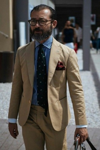 How to wear: tan suit, white and blue gingham dress shirt, dark green print tie, burgundy paisley pocket square