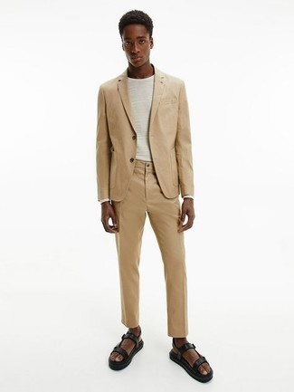 Black Leather Sandals Outfits For Men: This combination of a tan suit and a white horizontal striped long sleeve t-shirt will add casually neat essence to your getup. Feeling transgressive today? Change things up a bit by slipping into a pair of black leather sandals.