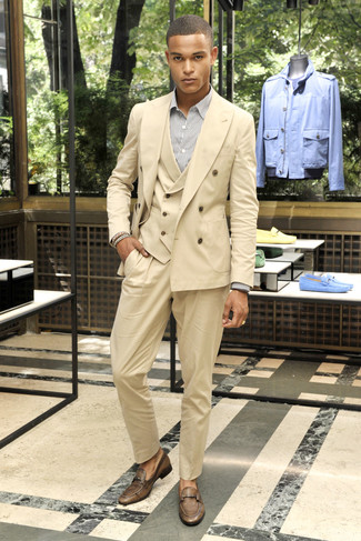 Rock a tan three piece suit with a white vertical striped dress shirt for a sharp classy look. Throw in a pair of brown leather loafers for a more relaxed aesthetic. You'll love to sport this combo throughout the summer season.
