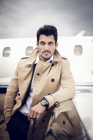 A tan trenchcoat and a black suit are among the key items of a versatile man's wardrobe.