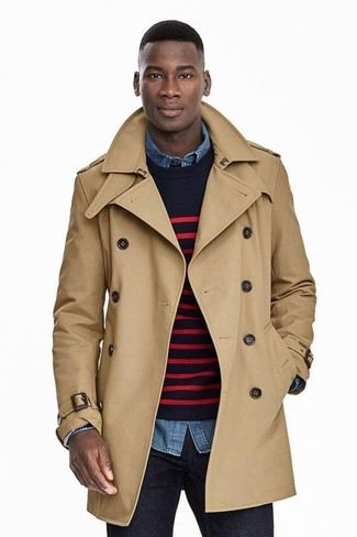 How to wear: tan trenchcoat, navy and red horizontal striped crew-neck sweater, blue denim shirt, navy jeans