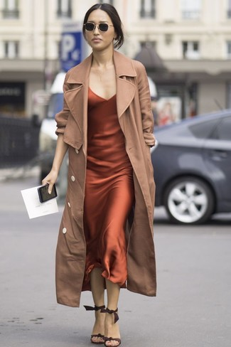 How to wear: tan trenchcoat, orange silk cami dress, dark brown suede heeled sandals, black sunglasses