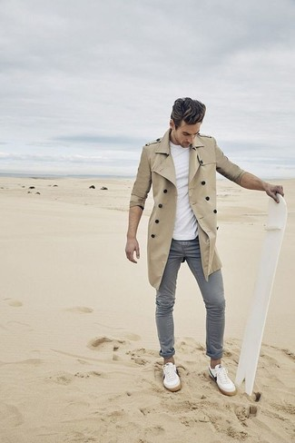 Pair a trenchcoat with grey casual pants to achieve a dressy but not too dressy look. Choose a pair of white low top sneakers for a more relaxed aesthetic.