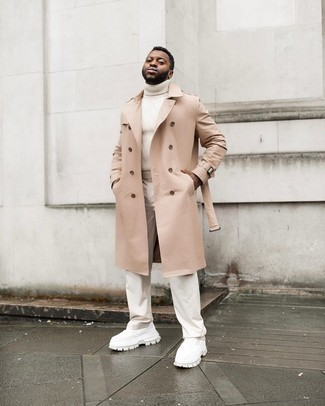 Trenchcoat Outfits For Men: A trenchcoat and beige chinos matched together are a match made in heaven for those who appreciate classy combos. And if you want to immediately tone down your look with one single item, complement this look with white athletic shoes.