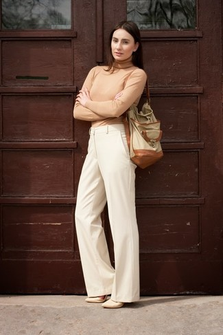 For a kick-ass-meets-totally chic getup, marry a tan turtleneck with beige wide leg pants — these two items go really good together. When it comes to footwear, this ensemble is finished off wonderfully with beige leather pumps.