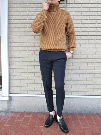How to wear: tan knit turtleneck, charcoal wool dress pants, black leather loafers, gold watch