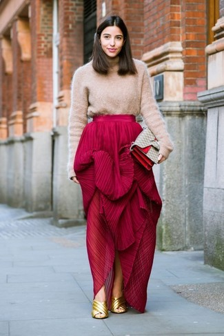 A nicely put together combination of a khaki wool turtleneck and a red pleated maxi skirt will set you apart effortlessly. You could perhaps get a little creative in the shoe department and lift up your outfit with gold leather mules. This look is our idea of perfection for when leaves are falling down and autumn is in the air.