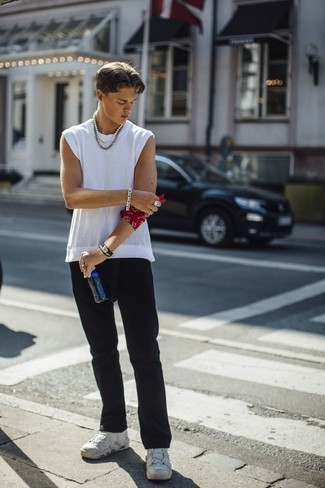 Bracelet Outfits For Men In Their Teens: Marrying a white mesh tank with a bracelet is a nice option for a casual ensemble. Finishing off with a pair of white athletic shoes is a fail-safe way to give an added dose of style to this outfit. Wondering what you should wear as a teenage boy? This pairing is a wonderful example.